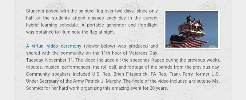 Students posed with the painted flag over two days, since only half of the students attend...